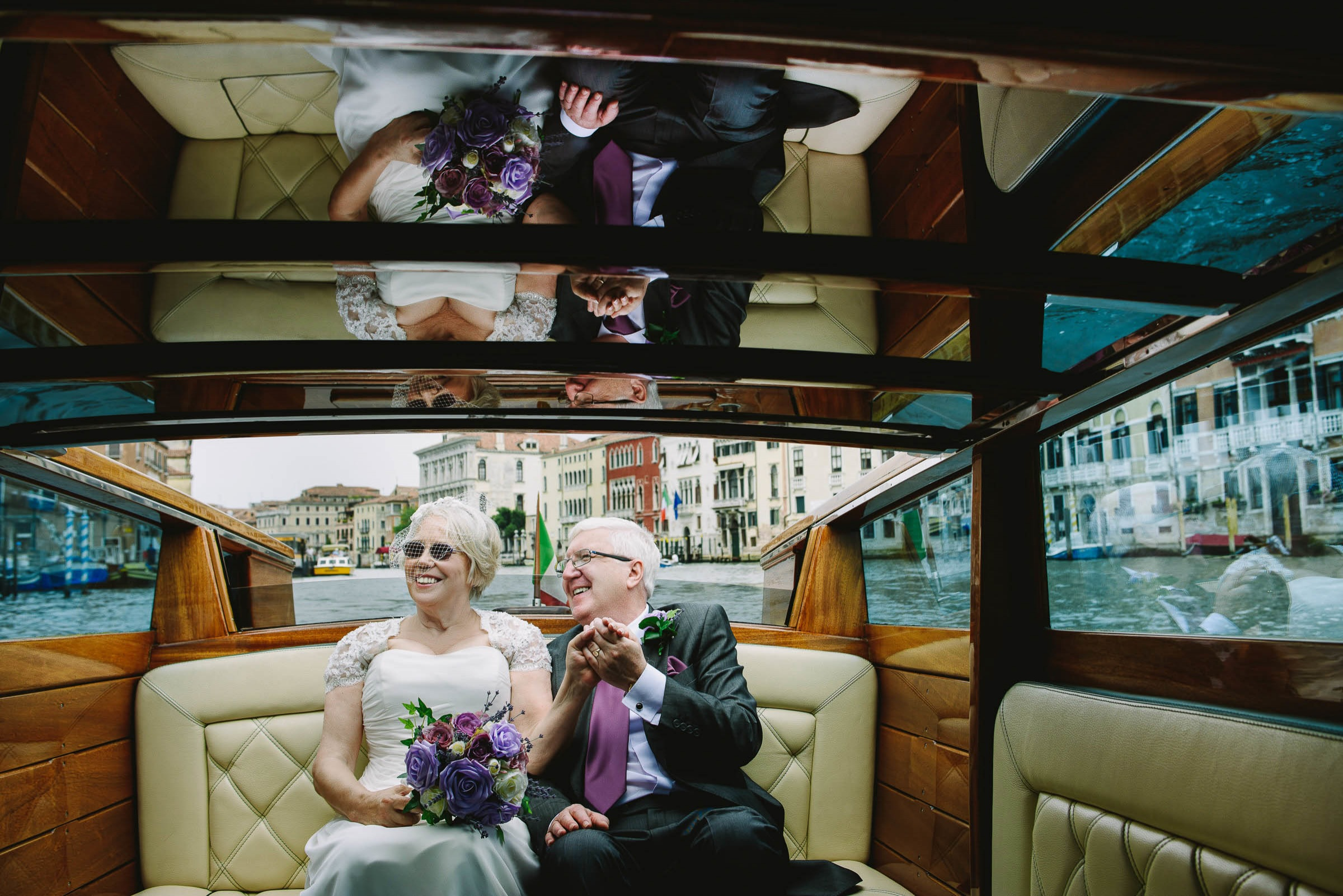 bride and groom in Venice water taxi
